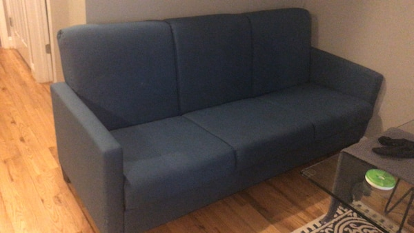 Blue modern/contemporary sofa with bed