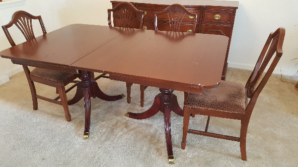 rectangular brown wooden table with four chairs ELLICOTTCITY