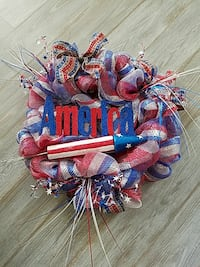 red and blue ribbon wreath