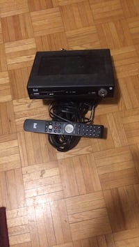 black Xbox 360 console with controller and game cases