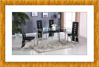 Glas top black table with 4 chairs