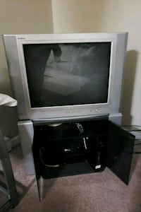 TV and stand set (remote included)  Coquitlam, V3K 4M3