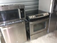 two gray front-load clothes washer and dryer set Orlando, 32822