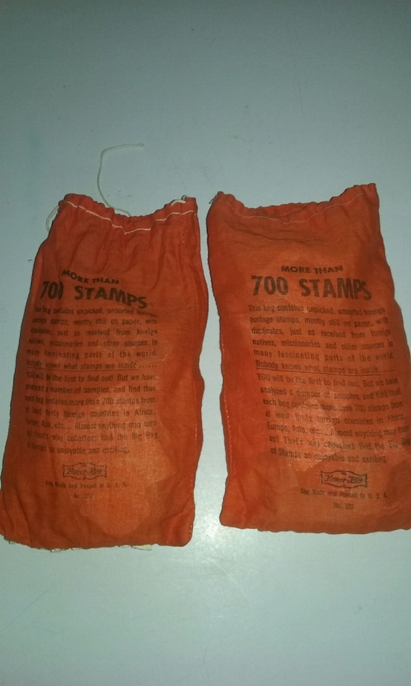 Two bags full of foreign stamps 792b4ced-91d8-489e-b983-e29f32cbd404
