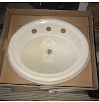 Round white ceramic bathroom sink with box