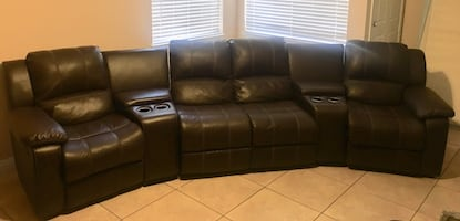 Dual reclining sofa with matching storage ottoman and rocker recliner.