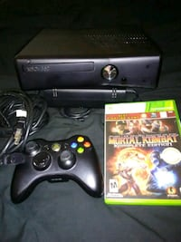 black Xbox 360 console with controller and game ca Donna, 78537
