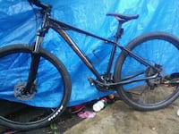 black and blue hardtail mountain bike Edmonton, T5B 0S1