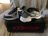 pair of white-and-gray Alpinetars sneakers with box