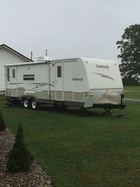 White and gray rv trailer London, 40741