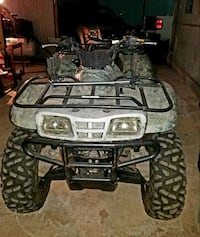 black and gray all-terrain vehicle Houston, 77084