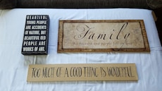 three assorted wooden wall decors
