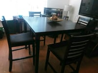 rectangular black wooden table with four chairs dining set El Paso, 79915
