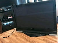 black flat screen TV with remote Anaheim, 92806