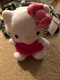 White and red hello kitty plush toy