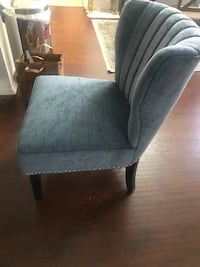 gray fabric padded wooden chair