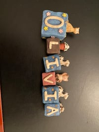 Block letters spelling Olivia Mississauga, L4Y 1X4