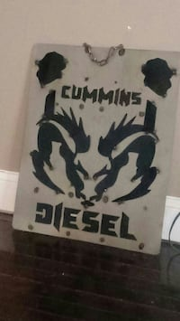 Cummins metal sign