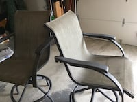 Two black metal framed outdoor swivel arm chairs Vaughan, L6A 3S2