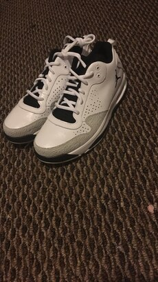 White and gray Air Jordan basketball shoes