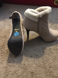 pair of gray suede chunky heeled booties 152 mi
