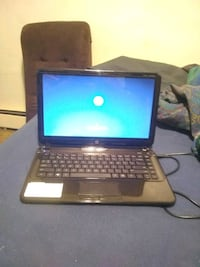 black and gray HP laptop Pitcairn, 15140