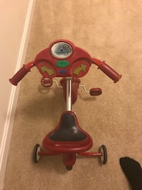 Red and black radio flyer tricycle  Pasadena, 21122