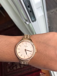 Fossil rose gold frame with a gold band Ottawa, K1T 2Y9