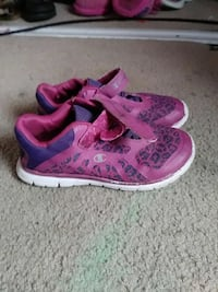 pair of pink-and-blue Champion running shoes