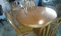round brown wooden table with four chairs dining set Elizabeth, 07206
