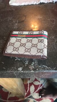 Black and gray gucci monogram bifold wallet