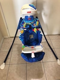 Fisher price cradle swing almost new it's has lights , music, 6 speeds, motorized mobile, two ways to swing