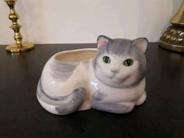 Grey and white cat planter with green eyes