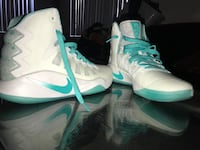Pair of white-and-teal nike basketball shoes