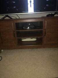 "Brown Entertainment/TV Stand. Sits up to 55"" Greensboro, 27405"