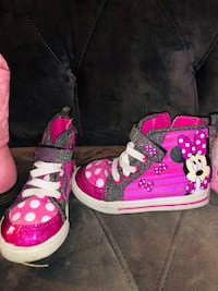 pair of pink-and-black high top sneakers 309 mi