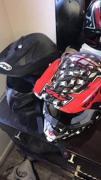 two black and red motocross helmets 54 km