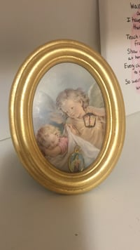 Angel beside girl sleeping painting with wooden frame Columbia, 21044