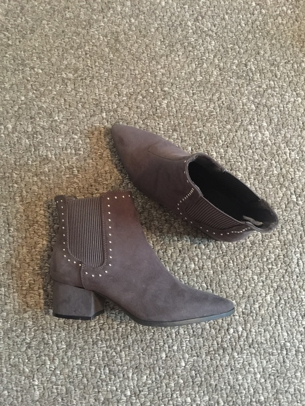 pair of brown leather chunky heeled booties