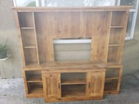 brown wooden TV hutch with cabinet Winter Haven, 33884