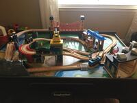 Blue and black rc helicopter, there's a drawer that fits a lot of the train pieces.  Comes with 4  trains and a crane.  What you see in the pictures is what it comes with. Minus the white train with markers all over it Modesto, 95356