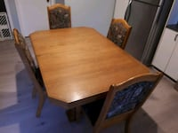 rectangular brown wooden table with four chairs di Montréal, H9J 1C1