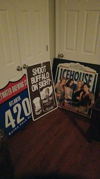 Beer and Bourbon Tin Signs.