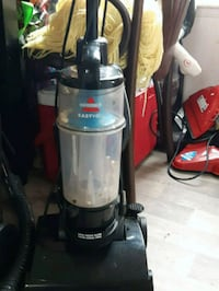 black and gray Bissell upright vacuum cleaner Westbank, V4T 1Z6