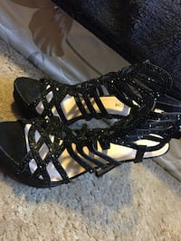 pair of black leather strappy sandals Clovis, 93611