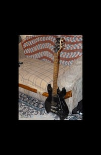 Black electric guitar signed by Paul Stanley from KISS band.  Kelowna, V1W 2C9