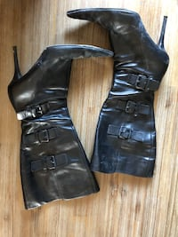 pair of black leather boots Laval, H7R 4V2