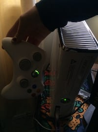 White xbox 360 console with controller