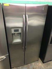 GE stainless steel side by side doors fridge in excellent condition
