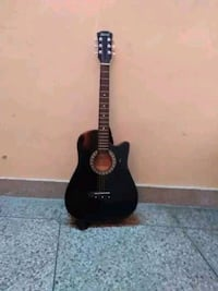 black and brown dreadnought acoustic guitar